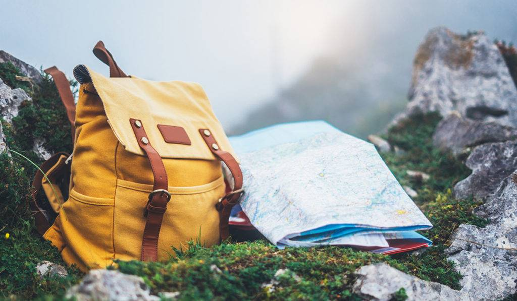 A backpack and map laid out during a hike
